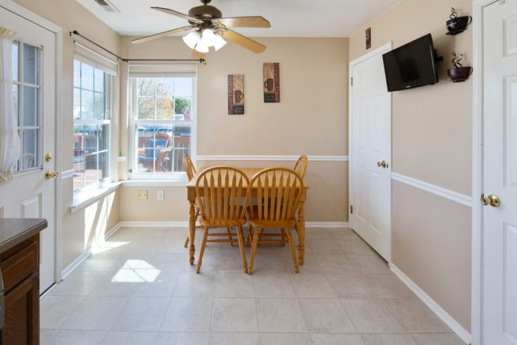 The eat-in area of the kitchen has tons of natural sunlight.