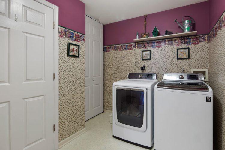 Laundry room has wallpaper