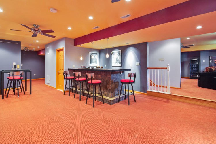 Basement features a wet bar and dramatic lighting package