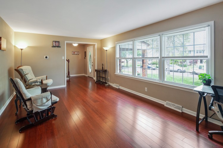 The living room has a tons of natural sunlight. 38 Pennsylvania Avenue Stratford