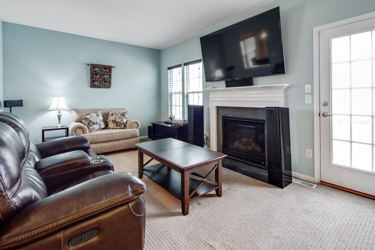 Family room has fireplace and door to the deck. 415 Concetta