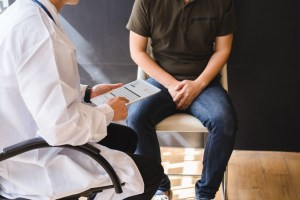 man talking to doctor about prostate health