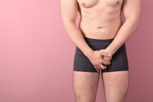 man in briefs covering up his genital area because of ED