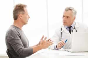 patient speaking with his physician