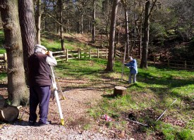 A 'dumpy level' and 'tape survey' in the woods at Hardcastle Crags