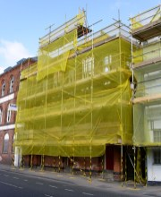 Demolition begins discreetly behind yellow screens