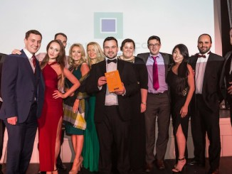 The team at McHale & Co pick up their award