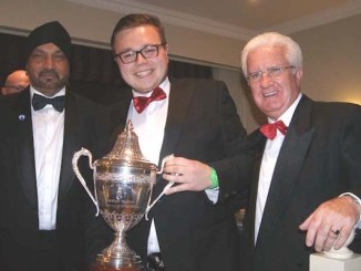 Mark Marshall receives the Scratch Trophy from Disha Ranshi and Peter Bradford