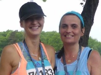 Elaine Cannon (right) with friend Sarah Nixon Carr after the Gothenburg half marathon