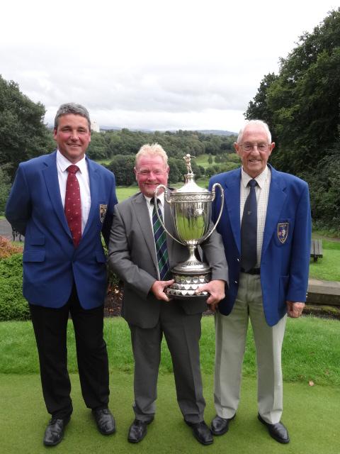 Andrew with Reddish Vale captain Tony Barnes and president Derek Wilson