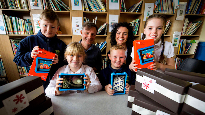 Newell Green Primary School students Noel Aitken, Matilda Stanley, Jessica Cope and Alfie Meadowcroft with Ashley Cowan and Hannah Moddy from Amazon