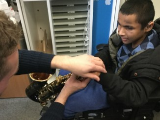 Matt Daly, Seashell Trust's assistive technologist, works on ideas for the saxophone with Seashell Trust student Samir Ahmed