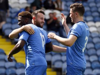 County celebrate Matty Warburtons goal against Macclesfield