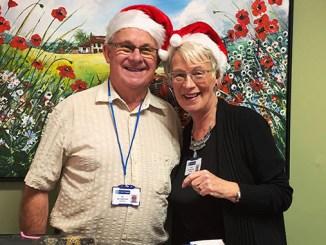 Ian and Jackie Springthorpe volunteering at one of the St Ann's Hospice Christmas fair