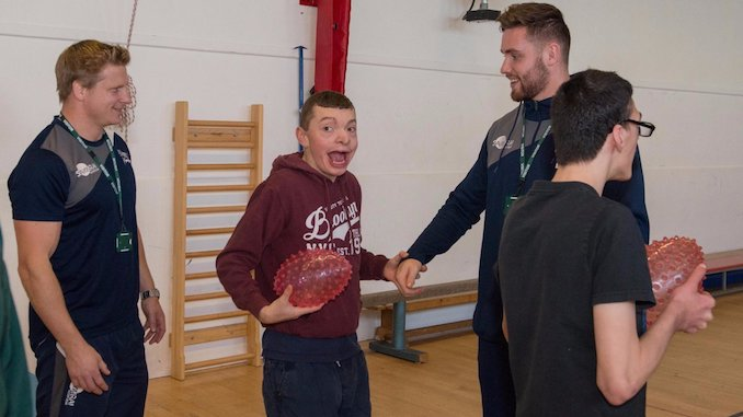 Sale Sharks players with Seashell Trust students