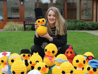 Rachel Astill, Francis House fundraiser, reveals some of the chicks for The Great Didsbury Easter Chick Hunt