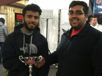 MGS pupil Shariq Haidery (left) receives his trophy