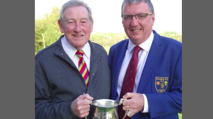 Andy Hart receives the Founders Trophy from Reddish Vale captain Michael Canning