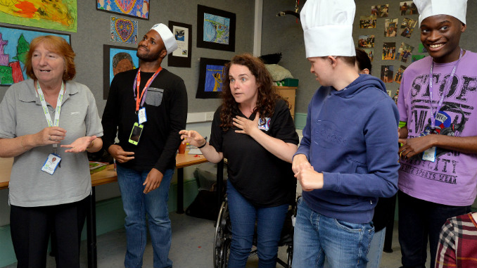 Learning support assistant Christine Caddick watches as students Shaquille Omonijo-Awofulu, Dan Follon and Khalil Mongeme take part in a workshop with Cherylee Houston