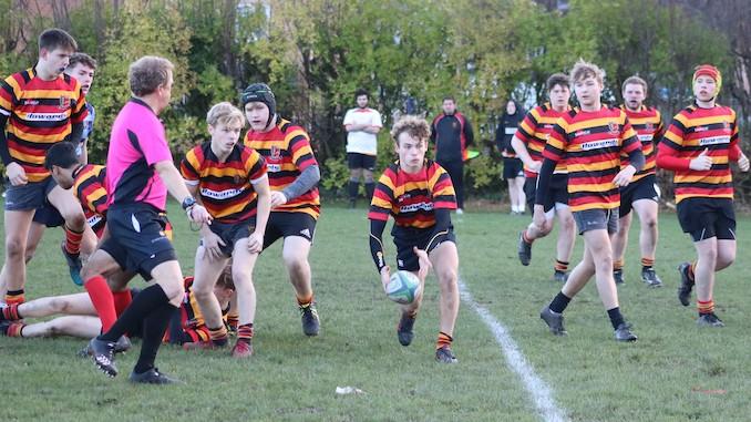 Charlie Pinhorn moves the ball for Heaton Moor