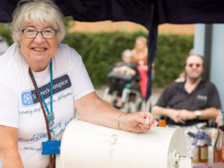 Anne Tinnion volunteering at the St Ann's Hospice summer fair