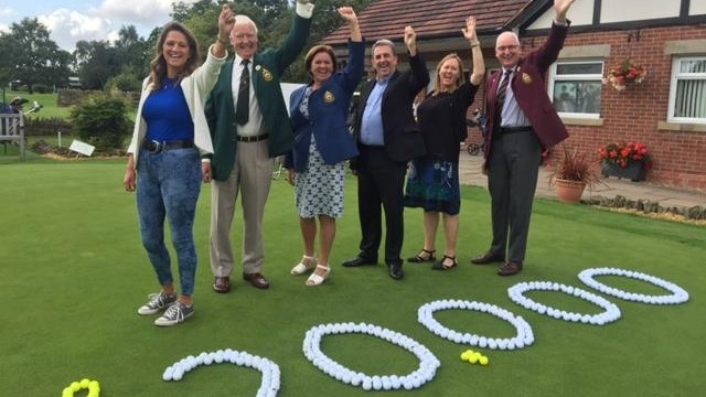 Golfers at Bramall Park celebrate their fundraising efforts for St Ann's Hospice