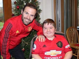 Manchester United midfielder Juan Mata with Toby at Francis House