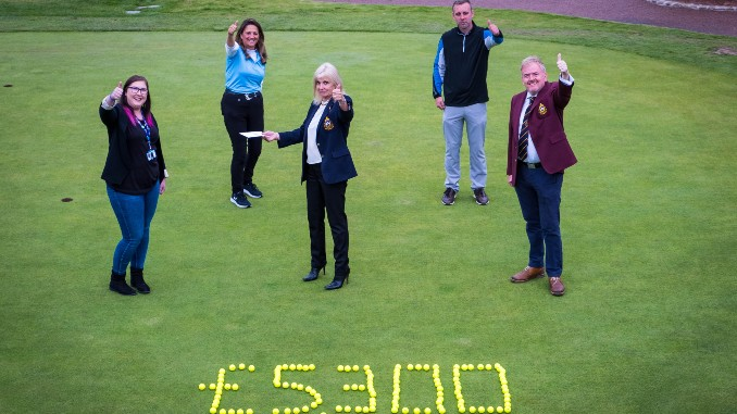Golfers at Bramall Park Golf Club celebrate their success