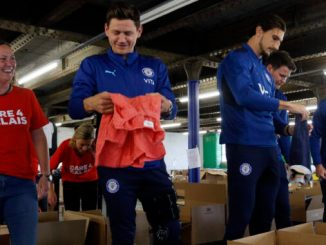 Stockport County's players led a hand at the charity's warehouse
