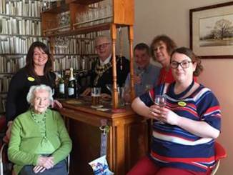 Front of House Manager Leinad White, resident Gladys Ladley, The Mayor of Stockport Councillor Andrew Verdeille, resident Dr Phillip Maddocks, Mrs Cleo Cundall, Natalie Ravenscroft (Regional Activities Executive) at the opening of The Residents' Bar