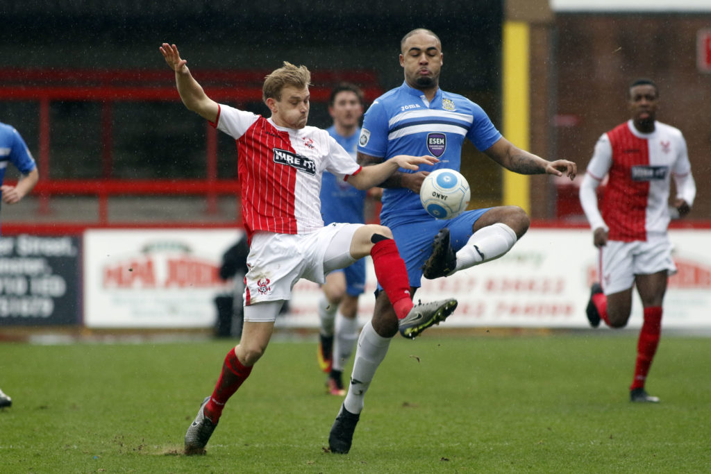 Courtney Meppen-Walters challenges for the ball, for Stockport at Kidderminster