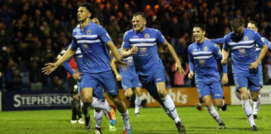 Lewis Montrose celebrates scoring his first goal for the Hatters