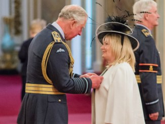 Sherann Hillman receiving her MBE from HRH the Prince of Wales at Buckingham Palace