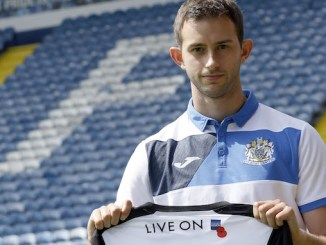 Stockport County striker Adam Thomas with the new shirt at Edgeley Park