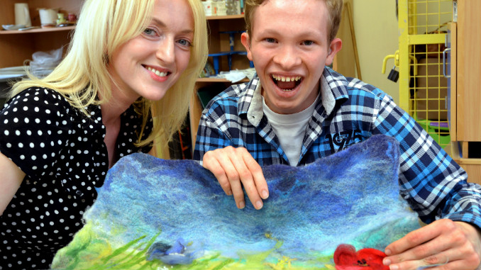 Seashell Trust artist-in-residence Lauren Mullarkey and Seashell student Dan Follon with the artwork that was exhibited at Buckingham Palace