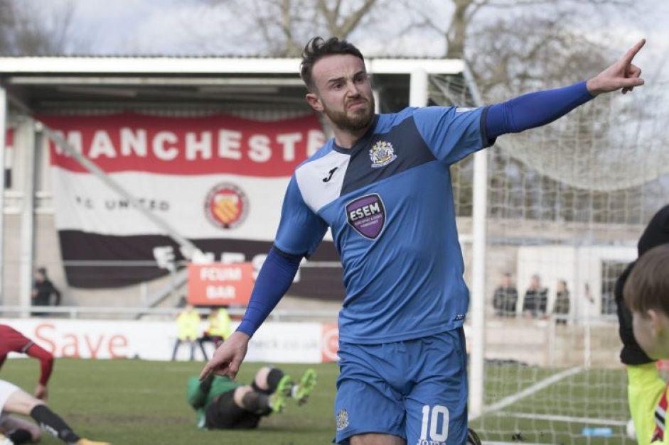 Matty Warburton celebrates his winning goal for Stockport, at FC United
