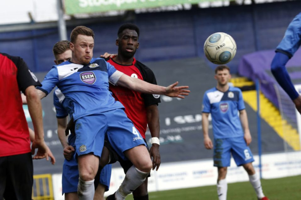 Paul Turnbull in the thick of the action for County