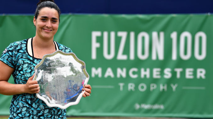 Ons Jabeur celebrates victory in the womens singles final of the Fuzion 100 Manchester Trophy