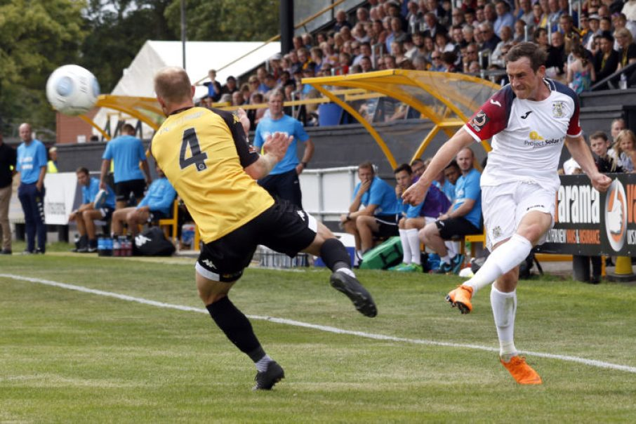 Sam Walker crosses the ball for County at Southport