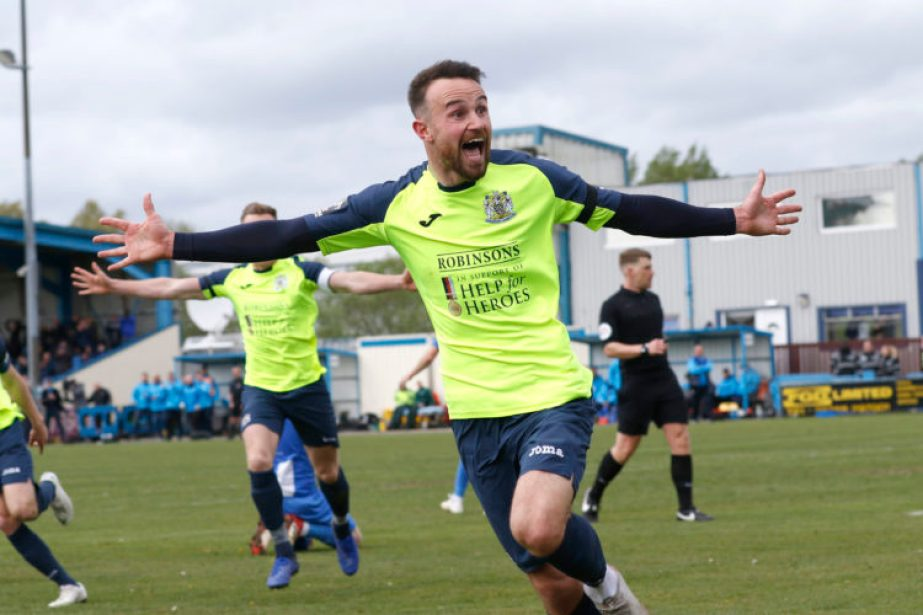 Matty Warburton celebrates his goal for Stockport