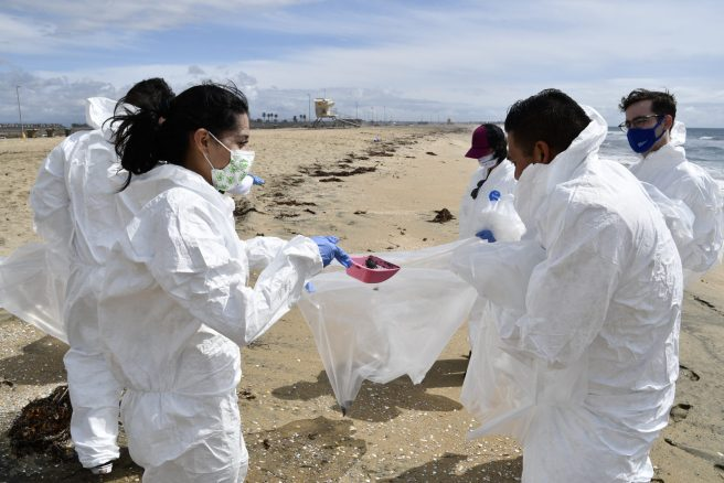 Volunteers Help with Oil Spill Clean Up at California Bolsa Chica State Beach Courtesy of USCG
