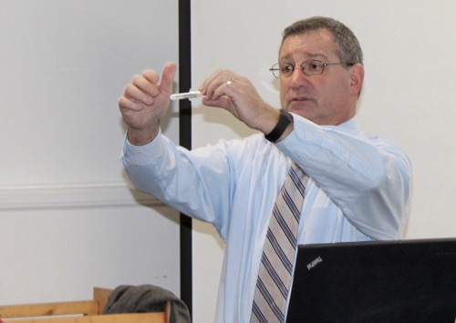Suffolk EMS director Robert Delagi demonstrates how to prepare a Narcan dose. Photo: Denise Civiletti
