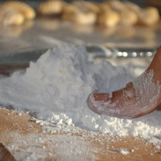Use a thumb touch a few corn flour before press