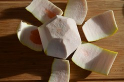 then slice thick pomelo rind off carefully.