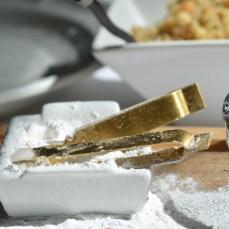 tip of small tong to tapioca flour