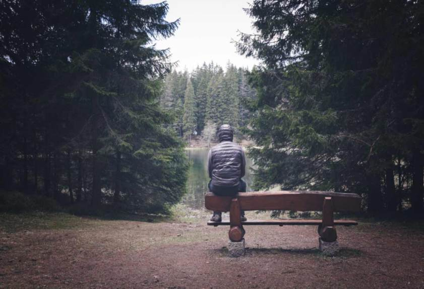 Sad man sitting alone on bench