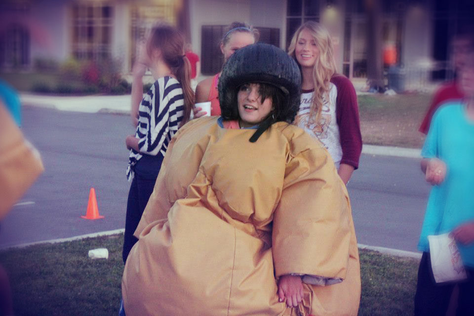 Girl in inflatable sumo suit
