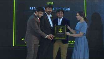 Dinesh Patel of Stellar receives the citation for the Best Retail Store of the Year