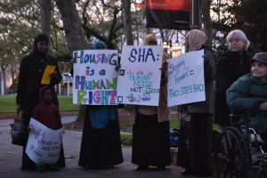 Demonstrators gather in front of the offices of the Seattle Housing Authority.