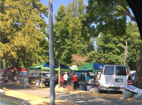 Image 3 Caption--The veterans share the lot with an unofficial farmer's market.